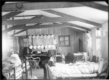 Interior of Hope Bay, Base D, Mar 1945. Thirteen occupied the hut during the austral winter, 1945. It was named Eagle House after the ship that brought in most of the building materials. (Photographer: Ivan Mackenzie Lamb; Archives ref: AD6/19/1/D168)
