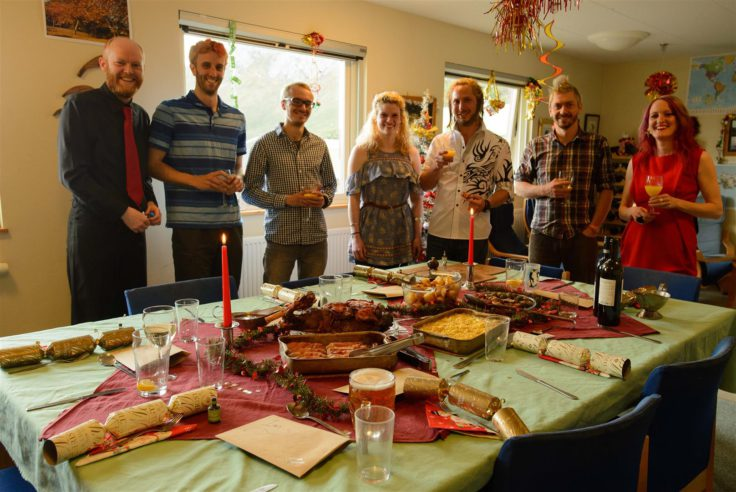The summer team before a hearty Christmas dinner