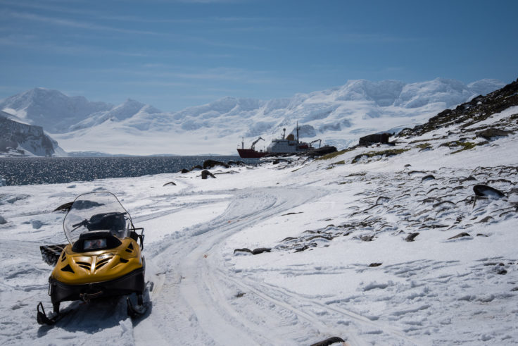 Signy Alpine 3 ski-doo with sledge. JCR anchored in the distance