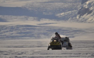 Travelling on skidoo between field camps on the Rutford Ice Stream.
