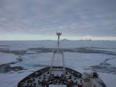 The RSS James Clark Ross in the Weddell Sea, with sea ice and icebergs