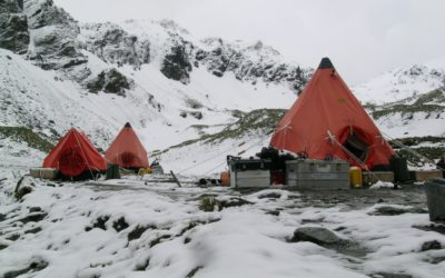 Field Camp at Centre Cove, Cooper Bay, South Georgia after a snow fall showing two pyramid tents and one pup tent. Scientists spent 2 months studying fur seal foraging behaviour and the geology of the region.