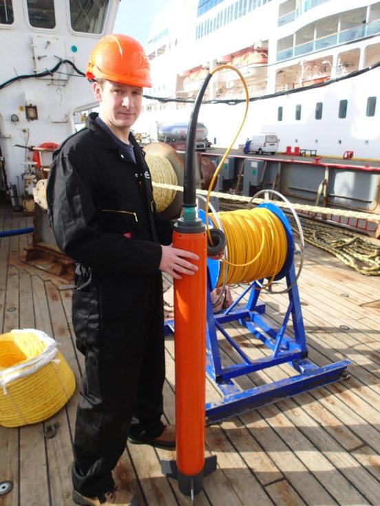 BAS geophysicist Tom Jordan prepares a magnetometer for deployment on the RRS James Clark Ross