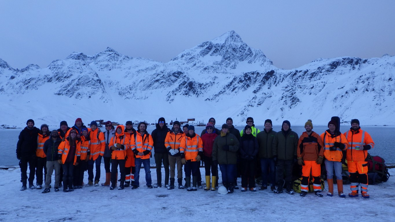 Group image of station and construction staff at King Edward Point after successfully completing the wharf.