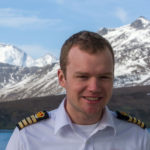 A profile photograph of Captain Will Whatley
