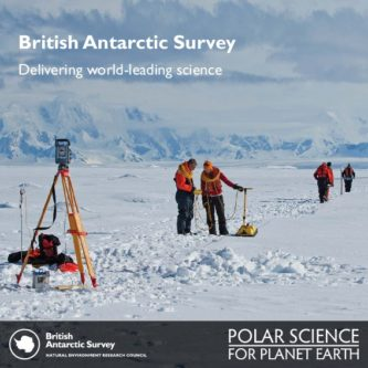 Scientists surveying the ground in an icy landscape with mountians in the background