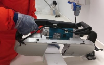 A person cutting into an ice core
