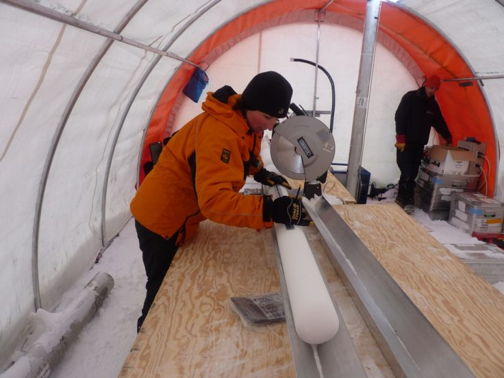 Liz Thomas measuring the ice core in the field