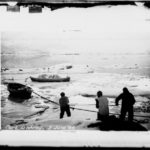 Hauling boats out of the sea ice, Port Lockroy, 3rd June 1944. (Photographer: E. Mackenzie (I.M. Lamb). Archives ref: AD6/19/1/A16