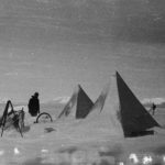 Field camp (Camp 'A') after a blizzard, during surveying expedition on Wiencke Island, 7th October 1944. (Photographer: E. Mackenzie (I.M. Lamb). Archives ref: AD6/19/1/A40/35