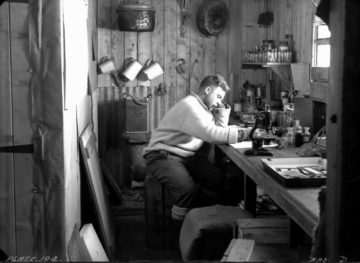 Norman Marshall, zoologist, working in the laboratory, Eagle House, Hope Bay, 22nd October 1945. (Photographer: E. Mackenzie (I.M. Lamb). Archives ref: AD6/19/1/D194)