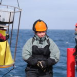 A photograph of Dr Sophie Fielding working onboard a ship