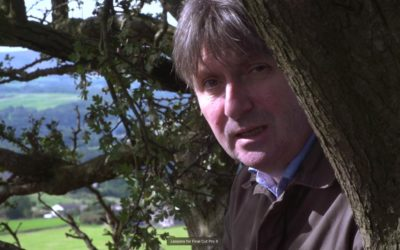 Simon armitage wearing a suit and tie.