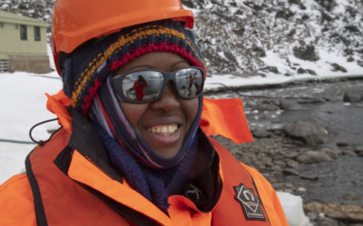 A woman wearing bright orange cold weather clothing