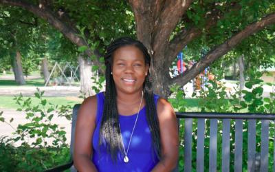 Black female scientist Melissa Burt sitting on a park bench