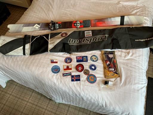 Photo of a ski bag, skis and ski badges