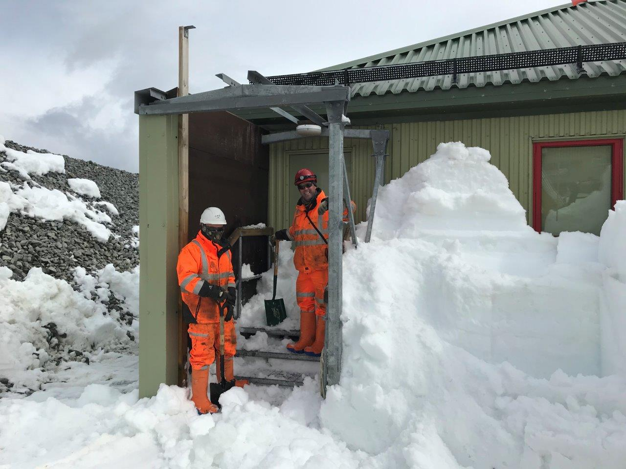 Construction team clearing snow at Rothera Research Station