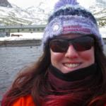 A woman wearing sunglasses taking a selfie