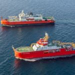 Two large red research ships in the ocean